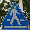 In Japan, the pedestrians on signs wear hats!