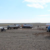 """Lots of trucks couldn't make it through the mud. Some were waiting until it dried up, and some were outright stuck. These are the """"roads"""" of Mongolia"""