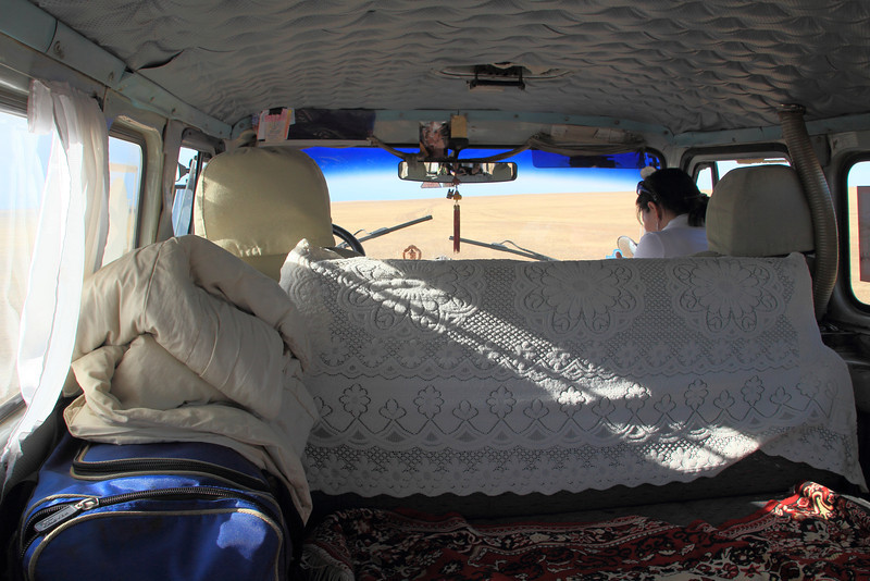 Inside our van. It was pretty cozy for five people, but it got hot because the back windows had to be held open.