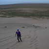 Climbing up a dune is really hard work. For every step you take, you slide back down half a step.