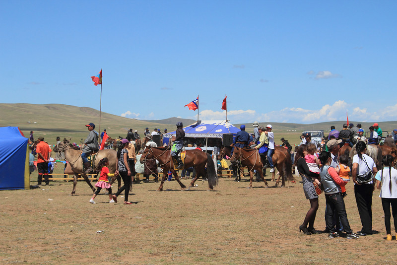 The next day, we stopped at a Naadam festival in a very small town. Every major town has one sometime in July, with the biggest in Ulaanbaatar on July 10 - 11. The three events are wrestling, archery, and horse racing.