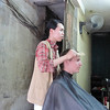 Getting a haircut in an alley