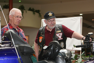 "Michael Olson a member of the Nebraska Gold Wing Road Riders Association Chapter ""W"" talks about many of the features on his bike with fellow Gold Wing owner Jim Trook. The club set up many of their Honda motorcycles at the Monument Mall on Saturday, recruiting new members and giving safety information."