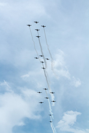 18 warbirds and transports in formation