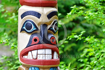 TotPol 00028 A well carved colorful face with big teeth totem pole detail, totem pole picture by Peter J Mancus