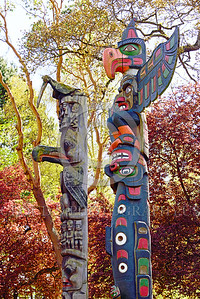 TotPol 00025 Two tall totem poles with different bird types on top totem pole picture by Peter J  Mancus