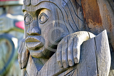 TotPol 00014 An unpainted human face with big lips totem pole detail, totem pole picture by Peter J Mancus