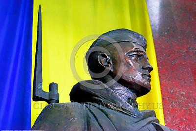 Ukrainian Soldier Statue 01 A proud heroic focused steadfast Ukrainian soldier with bayonet statue before colorful Ukrainian flag, statue picture by Peter J  Mancus