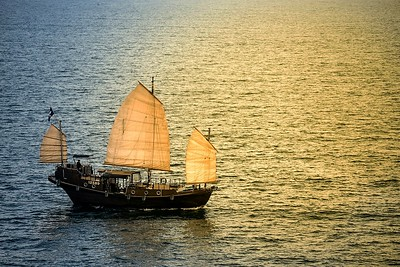 The Wing Sing junk sails into the sunset off the coast of Clearwater Bay in Hong Kong. December 2018.