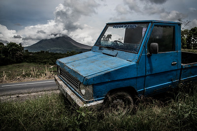 A blue truck abandoned at the side of the road near Mt. Agung in Sumatra, Indonesia. November 2017.