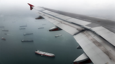 Coming in for a landing over the boat-laden waters of Singapore. November 2017.