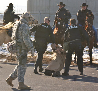 Some demonstrators are arrested trying to block trucks from leaving a Walmart distribution center in Loveland, Colorado. (12/12/11)