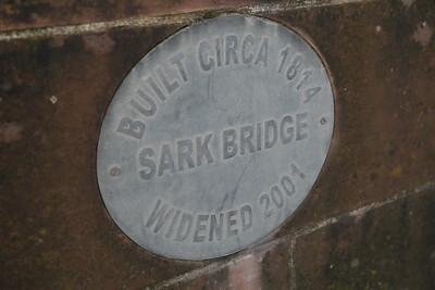 River Sark Bridge and signs at Gretna