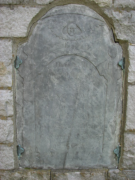 Ward's wife's original stone, embedded in the back of the gatepost