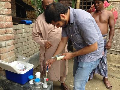 UM graduate student testing well water in Chanda village in Southwest Bangladesh. Photo credit: R. Reddy
