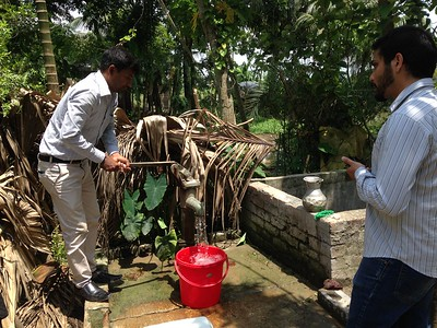 Preparing to collect a well water sample. Photo credit: R. Reddy