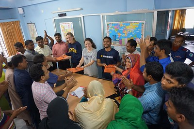 AAN staff and U-M graduate student researchers on the project team exchange gifts at a meeting at AAN Jessore. Photo credit: R. Reddy