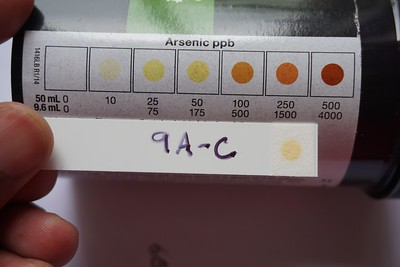 After a series of steps with different chemical reagents, the color that develops on a test strip is compared to a reference chart provided by the kit manufacturer. A darker color indicates a higher concentration of arsenic in the water sample. Photo credit: R. Reddy