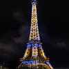 Eiffel Tower at night from the Seine River