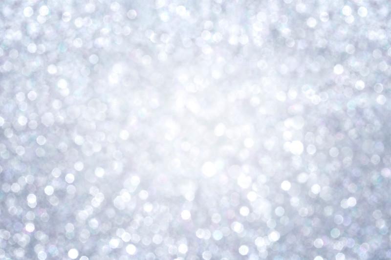 Shiny silver bokeh texture background