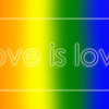 """Love is love"" text on rainbow colored background"