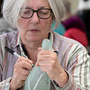 Leominster Senior Center held an art class at the center on Tuesday afternoon, Feb. 4, 2020. Painting some birch trees on a wine bottle at the class is Brenda Maffeo . SENTINEL & ENTERPRISE/JOHN LOVE