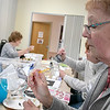 Leominster Senior Center held an art class at the center on Tuesday afternoon, Feb. 4, 2020. Painting a heart on a wine class is Linda Rivers. SENTINEL & ENTERPRISE/JOHN LOVE