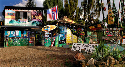 Planet Surf  DrewToonz painted the entire building in wonderful murals.  Photographed in 2003. The surf shop moved into Hale'iwa Town, the building has been repainted grey and is empty as of late 2008.  Corner of Pupukea and Kamehameha Hwy, across from Foodland, and Shark's Cove  North Shore of O'ahu Andrew Miller, artist