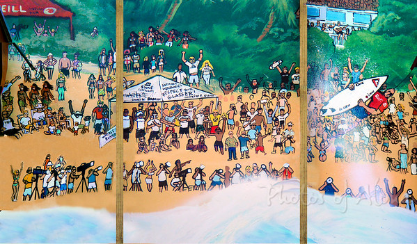 "DrewToonz surf mural 2004 (?)  Triple Crown Mural - Pipeline Sad story about this mural ~  I was going to buy it, but it  was totally ""lost"" to a coat of paint before I could buy it - biggest bummer ever! Here it was the backside of another mural which I pieced together from parts of photos I took before it was 'lost'. Andrew Miller, artist"
