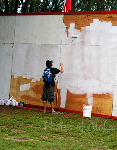 Drew priming the backdrop at Ehukai Beach Park, so he can paint another of his fabulous surf murals on it.  Xbox Gerry Lopez Pipeline Masters Banzai Pipeline, North Shore, Oahu 2003 Andrew Miller, artist