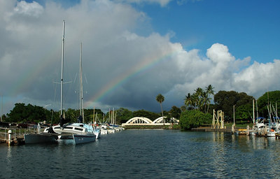 Rainbow over Analua Bridge in the Hale'iwa Harbor where sailboats are docked  North Shore, Oahu, Hawaii