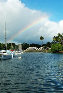 Rainbow over Analua Bridge in the Hale'iwa Harbor where sailboats are docked