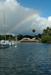 Rainbow over Analua Bridge in the Hale'iwa Harbor where sailboats are docked