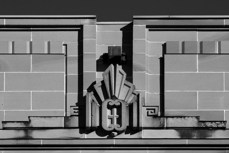 Main entrace parapet detail, Patents Office, Canberra. The building is now occupied by the Federal Attorney General's Department, and is  known as the Robert Garran Offices (b&w version).