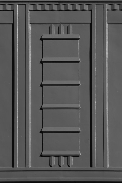 Detail of pressed metal window spandrel, Patents Office, Canberra. The building is now occupied by the Federal Attorney General's Department, and is  known as the Robert Garran Offices (b&w version).