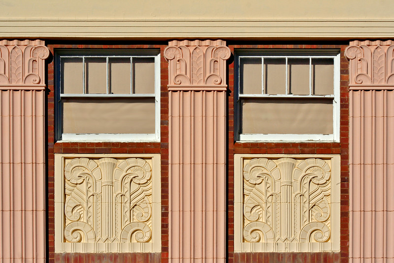 27 July, 2014: Bank of New South Wales building, Armidale, New South Wales. Detail of facade and spandrel mouldings.