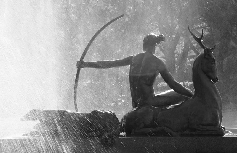 Diana the Huntress with hind and hounds amidst a spray of water droplets. Detail of the Archibald Fountain by Francois Sicard. Located in Hyde Park, Sydney, Australia.
