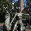Cityscape with monumental bronze sculpture of Diana with hind and hounds, by Francois Sicard. Part of the Archibald Fountain, Hyde Park.