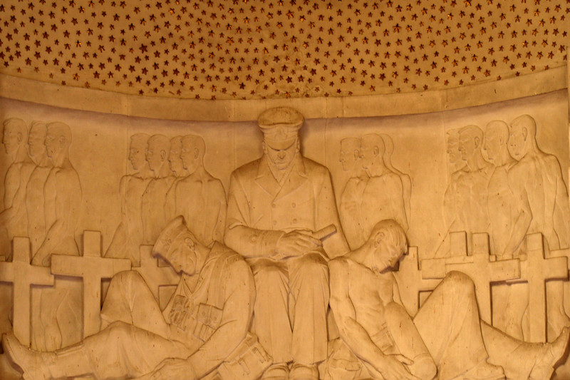 ANZAC War Memorial, Sydney. Interior detail showing relief sculpture of naval personnel by Rayner Hoff, immediately below the array of stars which carpet the domed ceiling.