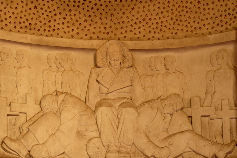 ANZAC War Memorial, Sydney. Interior detail showing relief sculpture of airforce personnel by Rayner Hoff, immediately below the array of stars which carpet the domed ceiling.