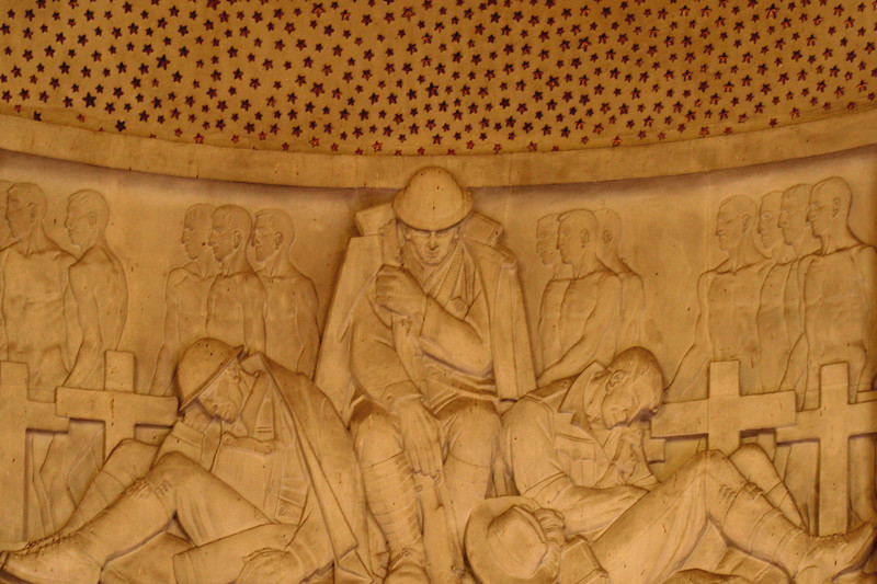 ANZAC War Memorial, Sydney. Interior detail showing relief sculpture of army personnel by Rayner Hoff, immediately below the array of stars which carpet the domed ceiling.
