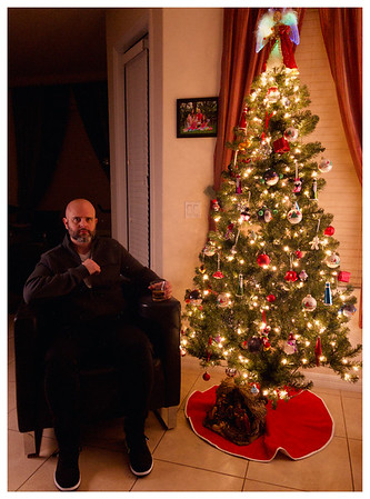 Christmas Self-portrait. Using $30 LED panels. Shot with Halide App camera. Edited with Darkroom iOS App.