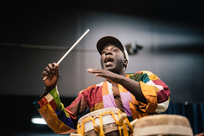 Pape Djouf Playing Sabar Drum, 2016