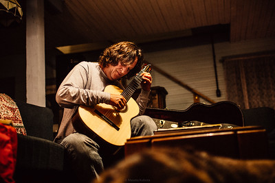Eric Slavin Playing Guitar Late at Night for Him and His Dog - Gila Hot Springs, New Mexico, 2012