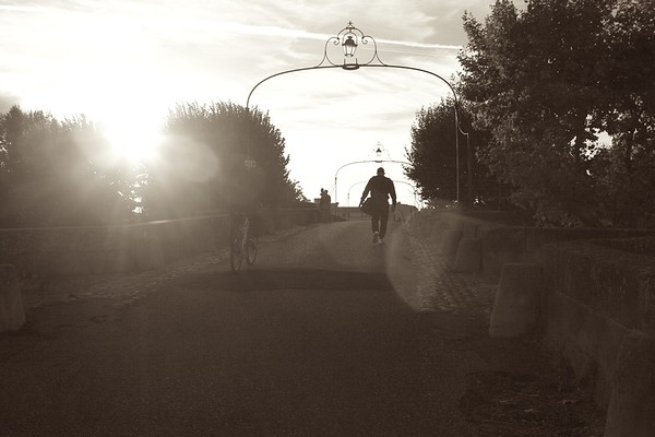 Crossing a bridge, Carcassone, France, 2013