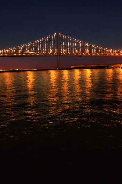 SF Bay Bridge at Night with Fiery Reflections
