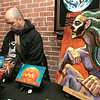 "The first Art haul was held at Strong Style Coffee in Fitchburg on Saturday, Jan. 4, 2020. Artist Scott Boilard of Worcester sets up his art at the show. The piece on the right, by Boilard, is called ""Ghost Receiving visions."" SENTINEL & ENTERPRISE/JOHN LOVE"