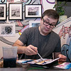 The first Art haul was held at Strong Style Coffee in Fitchburg on Saturday, Jan. 4, 2020. Artist Gary Hoare sat amongst some of his photography as he worked on a watercolor painting during the show. SENTINEL & ENTERPRISE/JOHN LOVE