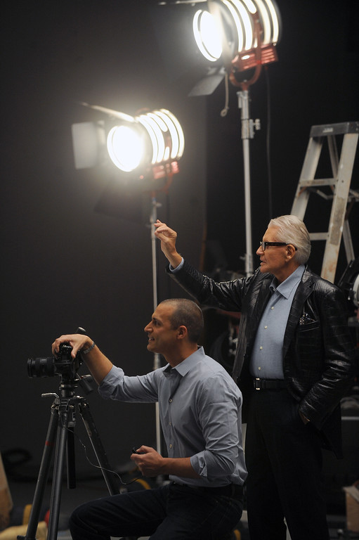 . Art Van Elslander, owner of Art Van Furniture gives the OK during a photo shoot with internationally renowned fashion photographer Nigel Barker. Macomb Daily File Photo/DAVID DALTON