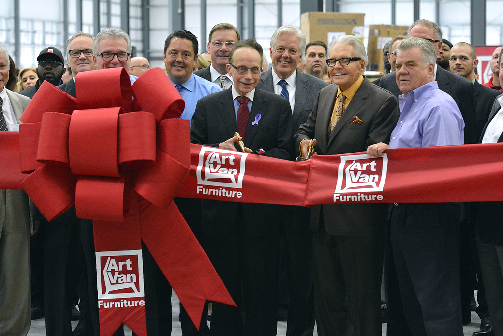 . Warren Mayor James Fouts and Art Van Furniture Chairman and Founder Art Van Elslander cut the ceremonial ribbon at the announcement of Art Van\'s new $11 million expansion warehouse. (Ray skowronek/The Macomb Daily)